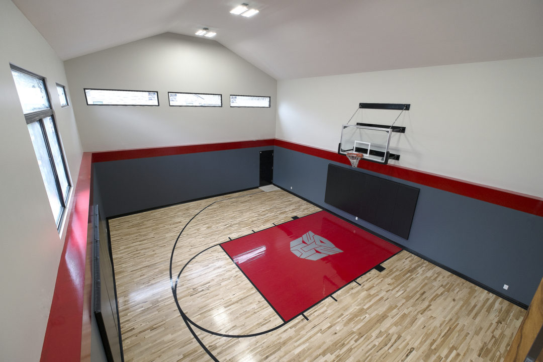 Basketball court orange design build for Custom basketball court cost